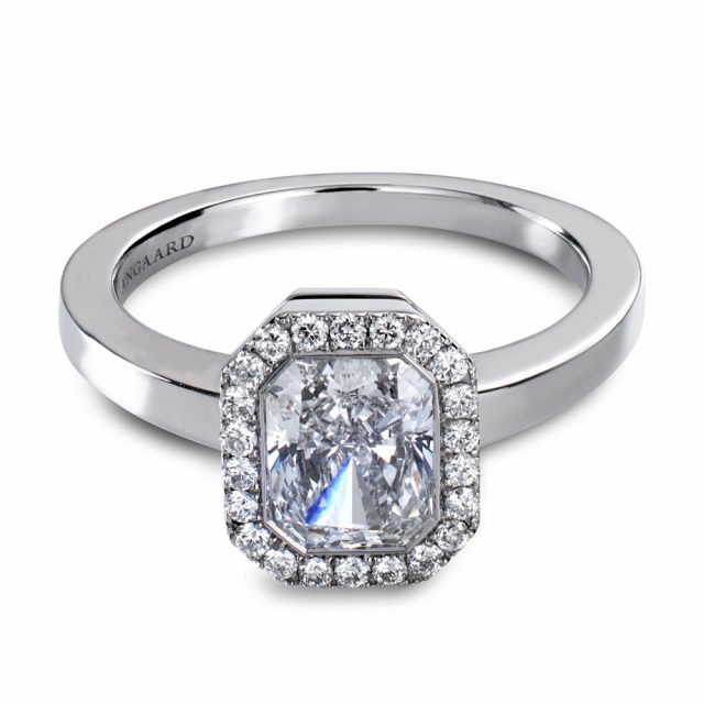 Radiant cut engagement ring with halo in platinum