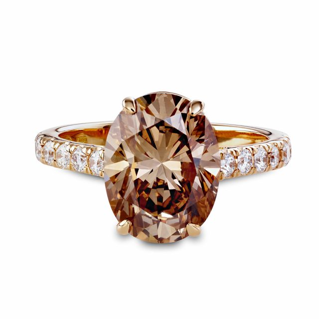 Oval cut champagne coloured diamond ring in rosé gold