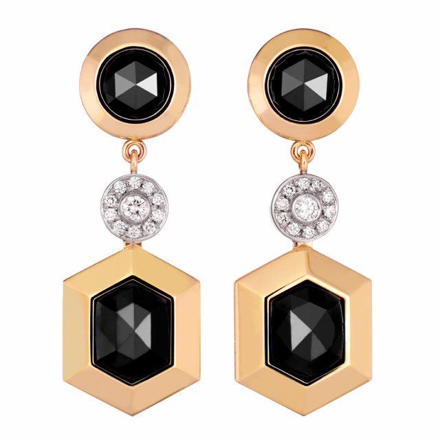Ørepynt i rosé og hvitt gull med sorte og hvite diamanter