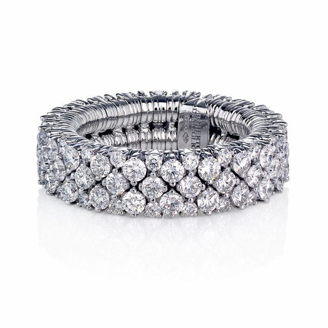Elastisk ring i hvitt gull med briljantslipte diamanter