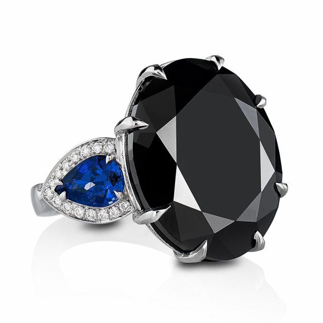 Ring in platinum with oval black diamond and sapphires