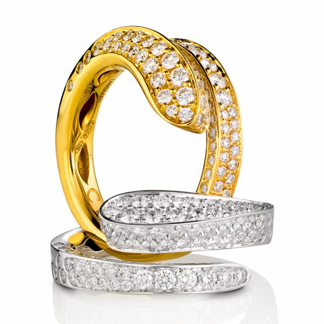 Open rings in yellow and white gold with diamonds