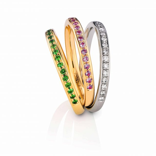 Eternity rings with colored gemstones and diamonds